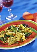 Pasta with basil sauce and vegetables