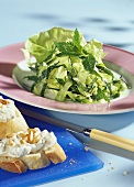 Mint salad and white bread with pine nut spread