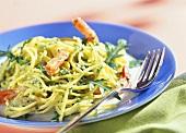 Spaghetti with pesto, rocket and shrimps
