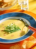 Cream of sweet corn soup with lettuce strips & diced ham