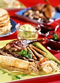 Chinese Peking duck with accompaniments and sauces