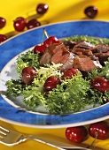 Lamb fillets with balsamic heart cherries on curly endive