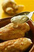 Chicken breast with ginger yoghurt mousse in baking dish