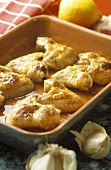 Chicken wings with honey and garlic in baking dish