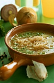 Onion soup with parsley in soup cup