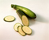 Courgettes, one with a piece cut off