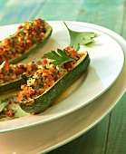 Stuffed courgettes with diced ham and vegetables
