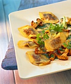 Potato ravioli with chanterelles & herb vinaigrette