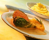 Pheasant breast in cabbage with apple and rosemary puree