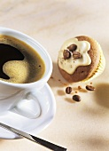Black coffee and mocha muffin with coffee beans