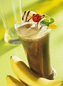 Coffee smoothie with bananas and fruit kebab