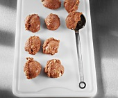 Making rissoles: forming the rissoles in a ladle