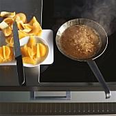 Caramelising orange segments