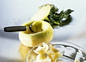 Hollowing out kohlrabi with melon baller
