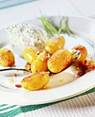 Whole fried potatoes with herb quark and diced bacon