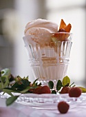 Rose ice cream with raspberries and strawberries in glass
