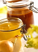Brown stock and chicken stock in jars