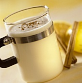 Hot advocaat drink with cinnamon