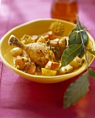 Chicken leg with almonds, potatoes, carrots & bay leaf