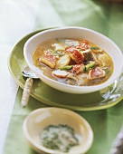 Fish soup with lobster tails and mangetouts