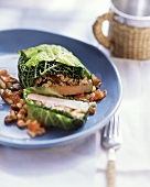 Pork loin wrapped in savoy with raisins and pine nuts