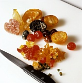 Finely chopping mixed candied fruits