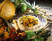 Caramelised diced pumpkin with spring onions on rice
