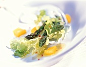 Salad leaves with green asparagus and vinaigrette