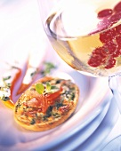 Assorted nibbles and Prosecco with redcurrants