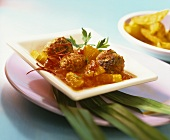 Meatballs in tomato and orange ragout with strips of chili
