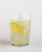 Glass of lemonade with slice of lemon