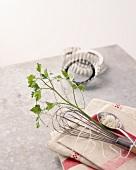 Various cooking utensils, salt and parsley