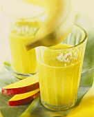 Banana drink with kiwi fruit and grated coconut