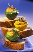 Mini-pumpkins with spicy stuffing on slices of bread