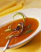 Carrot soup with ginger, spring onions and star anise