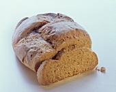 Farmhouse bread with a slice cut