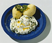 Boiled potatoes and parsley quark with linseed oil