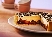 Plum tart with advocaat cream and chocolate strips