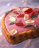 Love cake with pink icing and sugared flowers