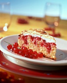 Piece of redcurrant and almond meringue cake