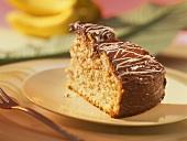 Piece of banana cake with chocolate icing