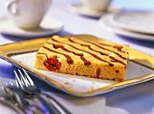 Piece of Baileys cake with Morello cherries