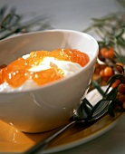 Quark with sea buckthorn jam in white bowls