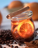 Coffee jelly with orange slices in jam jar