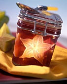 Red wine jelly with carambola in jam jar