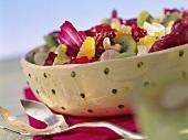 Mixed salad with kiwi fruits, oranges and walnut dressing