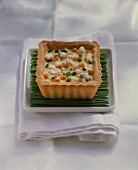 Small vegetable quiche with mozzarella on chives