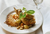 Rabbit legs with pearl onions, rosti and basil