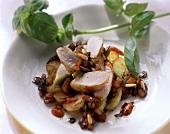 Fried potato salad with rabbit, pine nuts, basil
