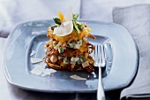 Rosti tower with vegetables and Parmesan shavings